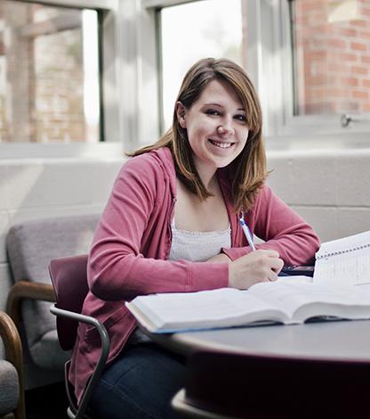 girl smiling at desk