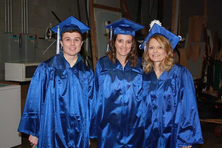 Three students in their caps and gowns