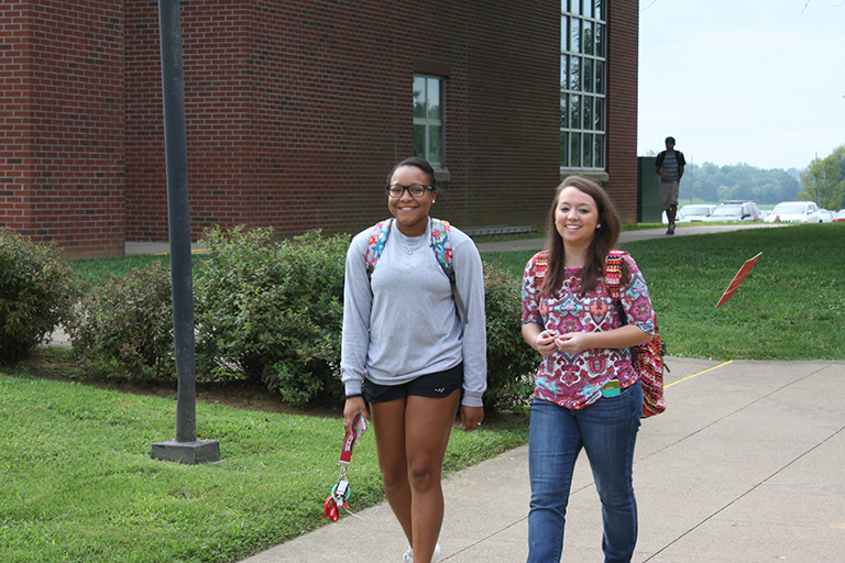 two girls walking on campus